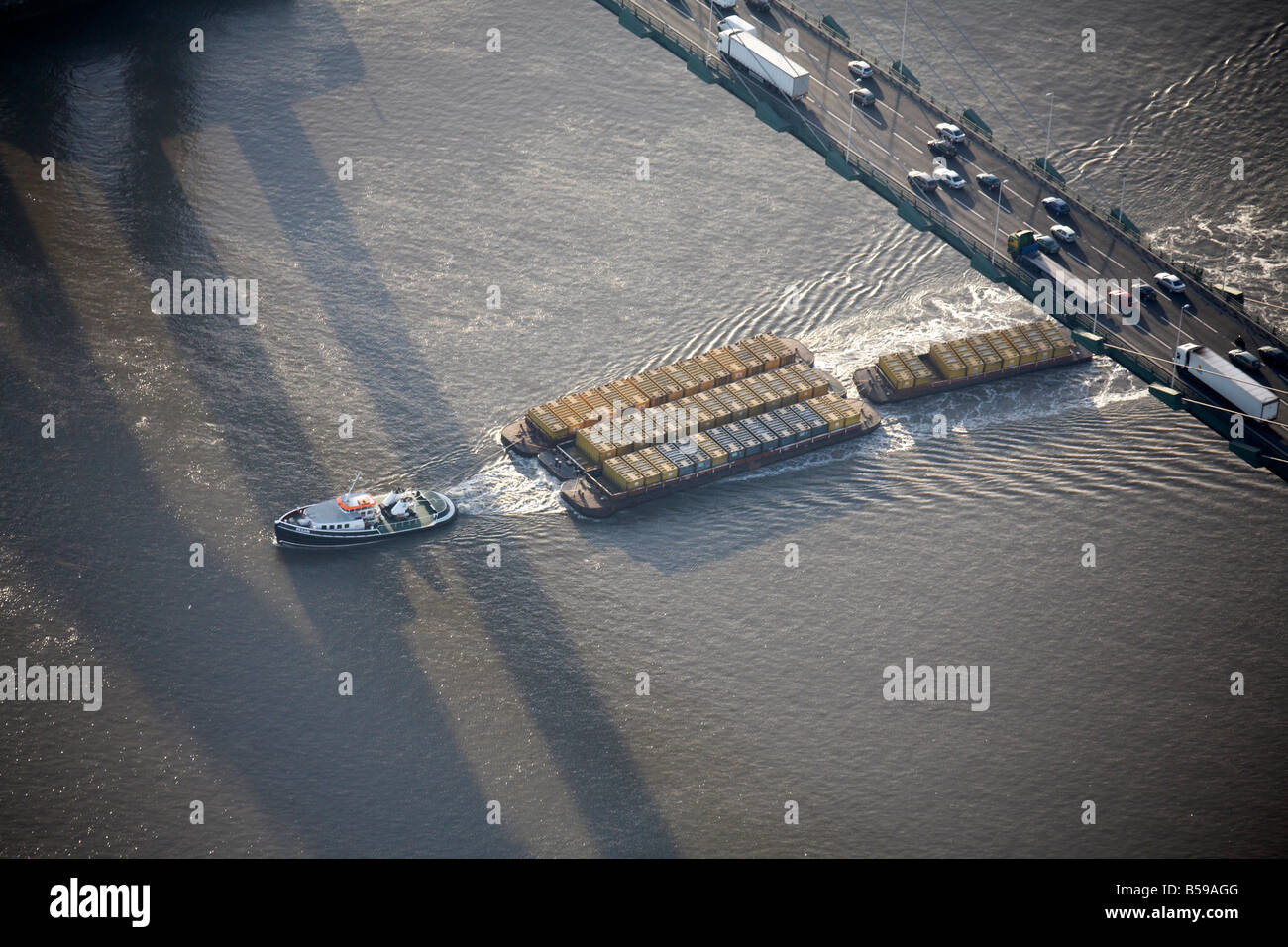 Aerial view south west of Queen Elizabeth II Bridge River Thames boat cargo water ripples Dartford London DA1 England - Stock Image