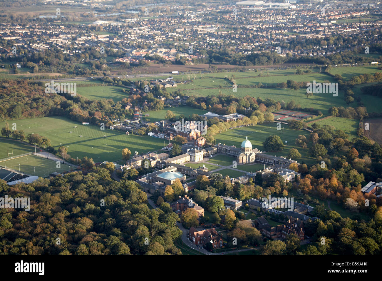 Aerial view south east of Haileybury College playing fields tennis courts A10 road suburban houses Hertfordshire - Stock Image