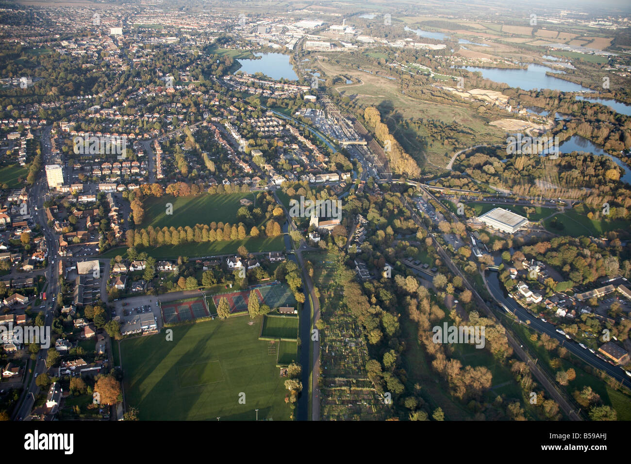 Aerial view north east of Lee Valley Park Admirals Walk Lake Slurry Pit suburban houses allotments sports grounds - Stock Image