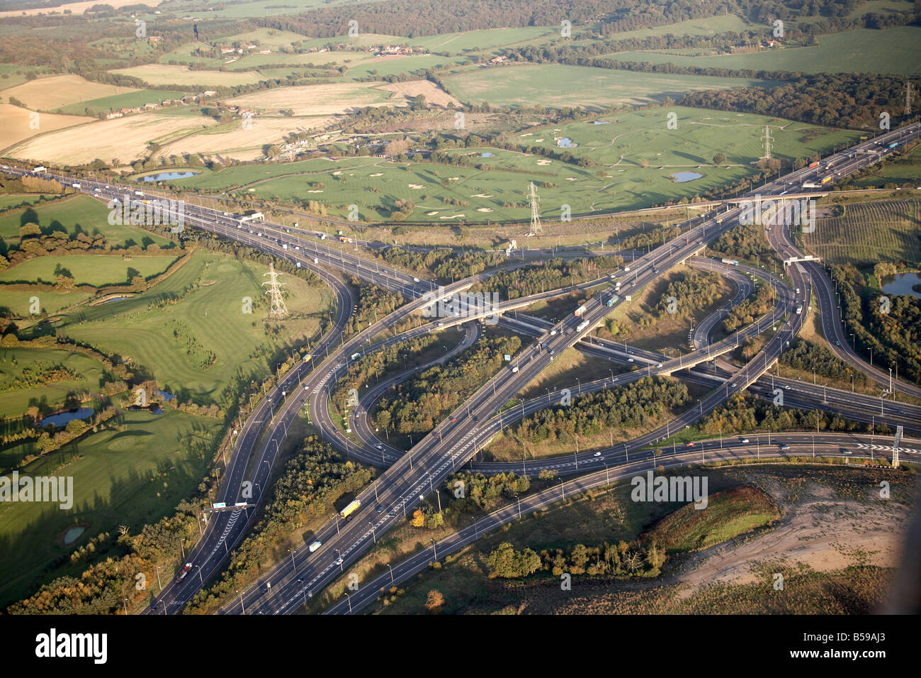 Aerial view east of M25 Motorway Junction 27 M11 Motorway Junction 6 Hobbs Cross Golf Centre country fields Epping - Stock Image