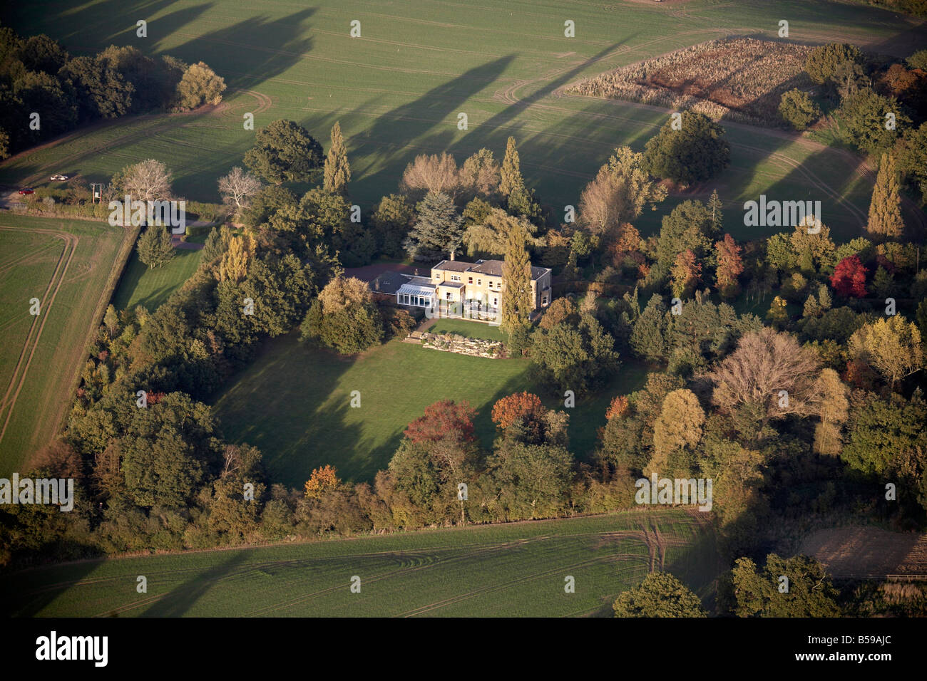 Aerial view north east of country house and garden country fields trees Hoe Lane Lambourne Romford Epping Forest - Stock Image