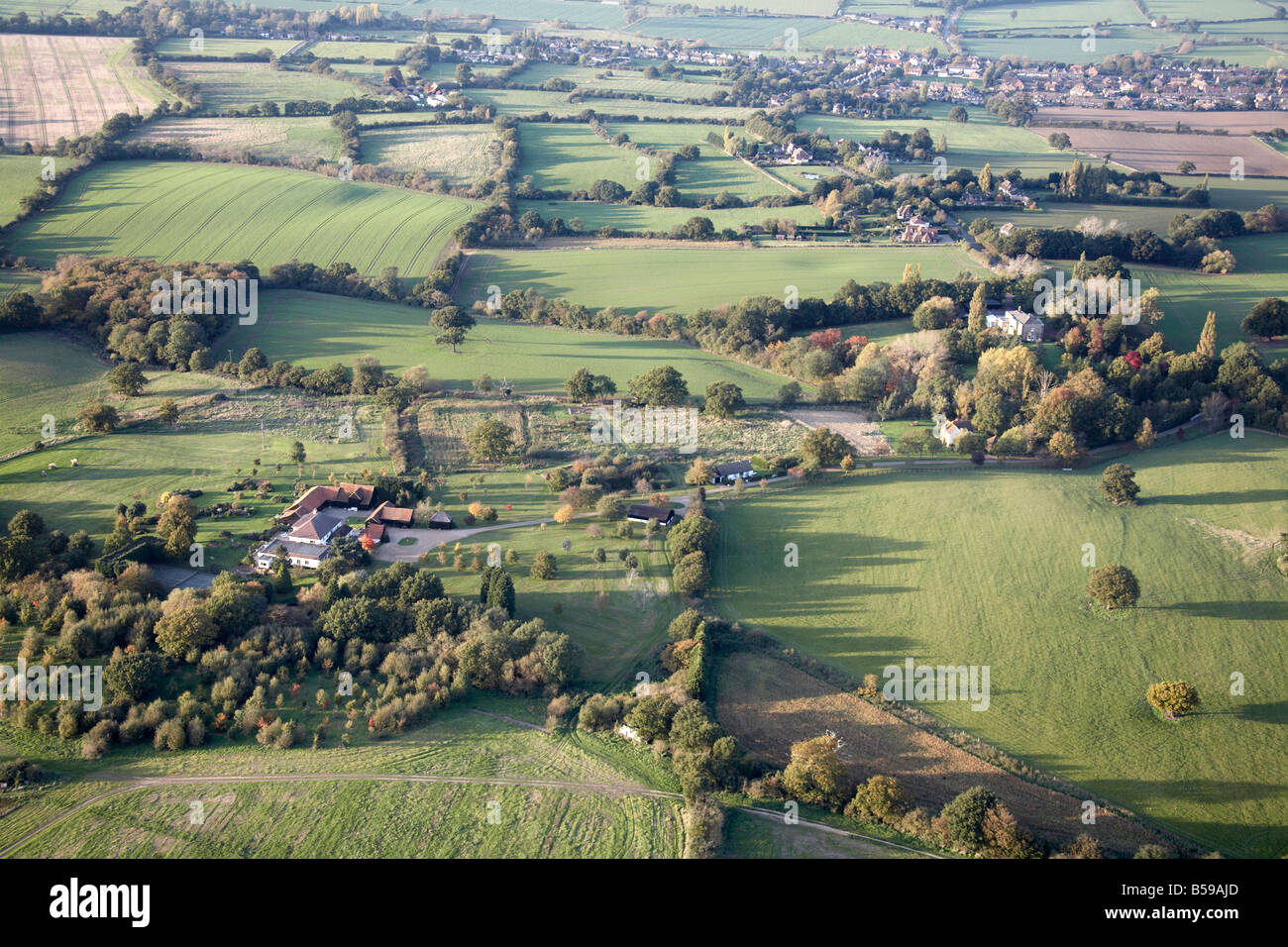 Aerial view north west of The Bungalow country houses Lambourne Abridge country fields trees Romford Epping Forest - Stock Image