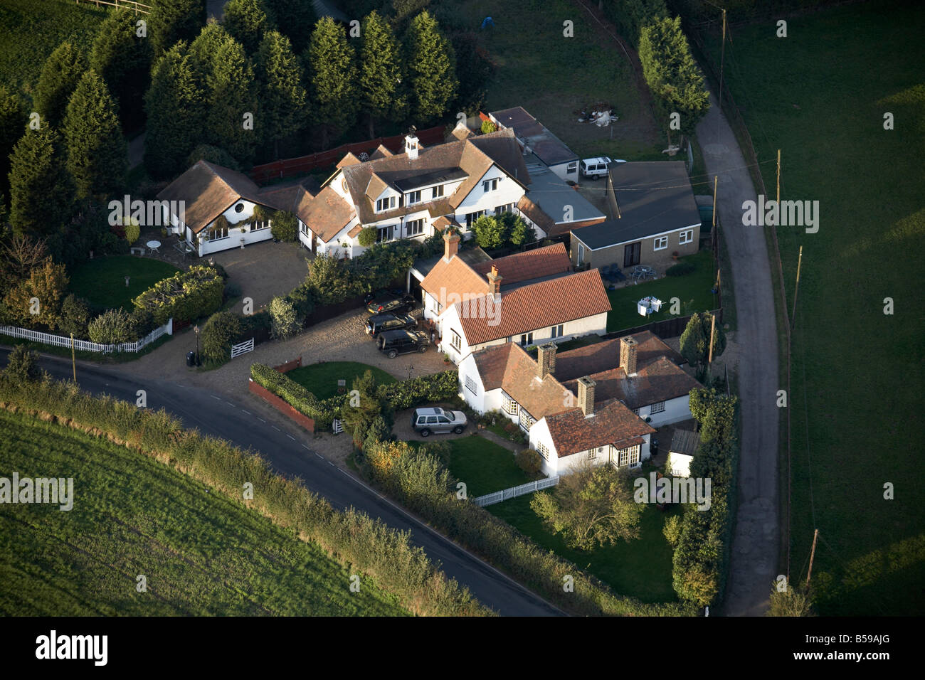 Aerial view north east of country houses conifer trees New Road Lambourne Romford Epping Forest London RM4 England - Stock Image