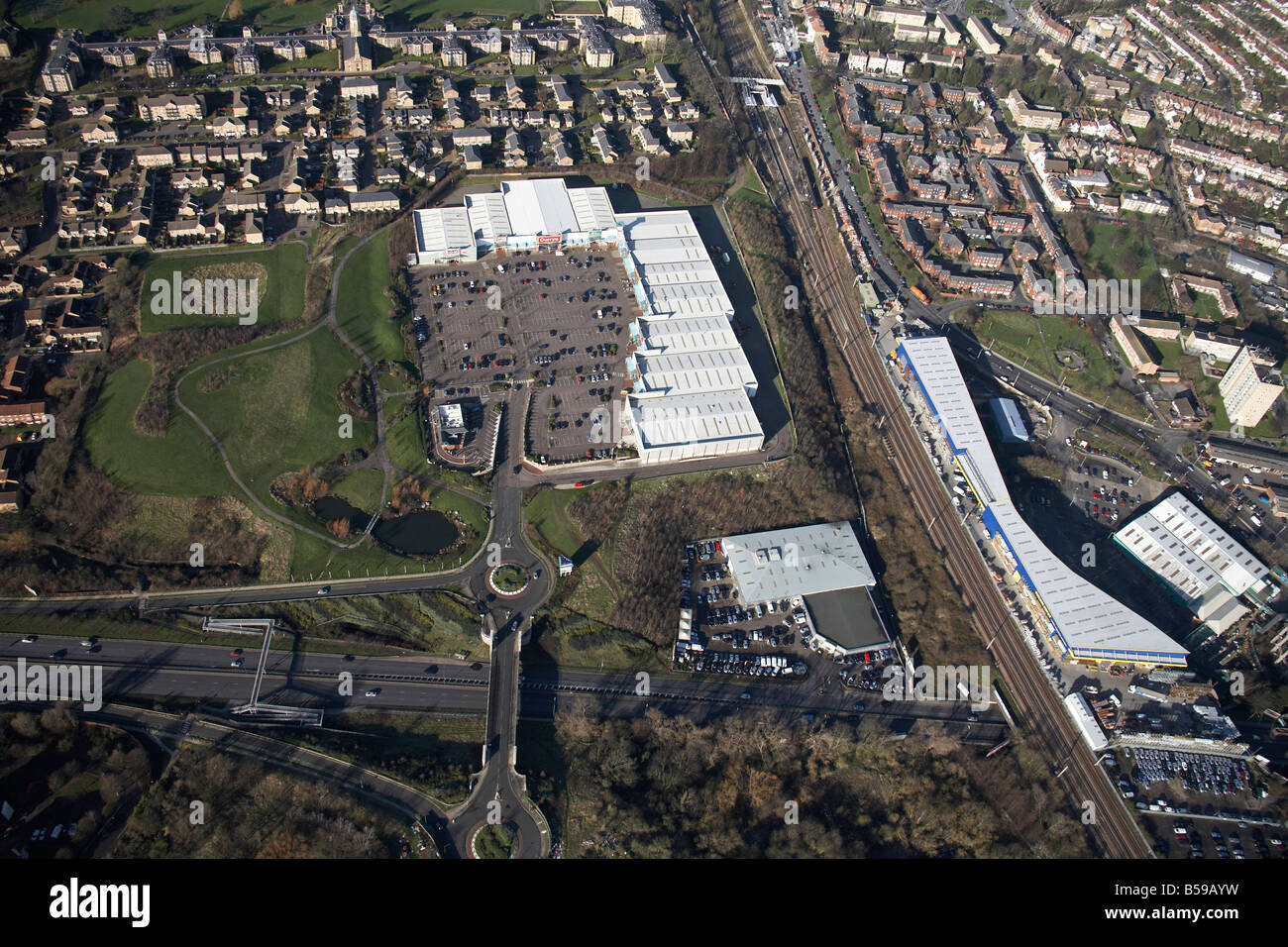 Aerial view north west of Friern Bridge Retail Park depot railway line Pinkham Way A406 suburban houses New Southgate - Stock Image
