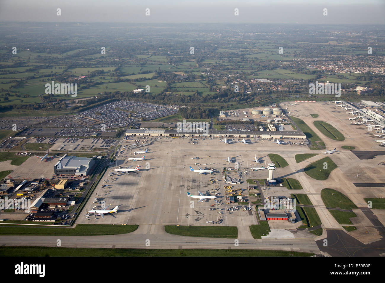 Aerial view north west of London Gatwick Airport runways aeroplanes country fields Crawley West Sussex RH6 England - Stock Image
