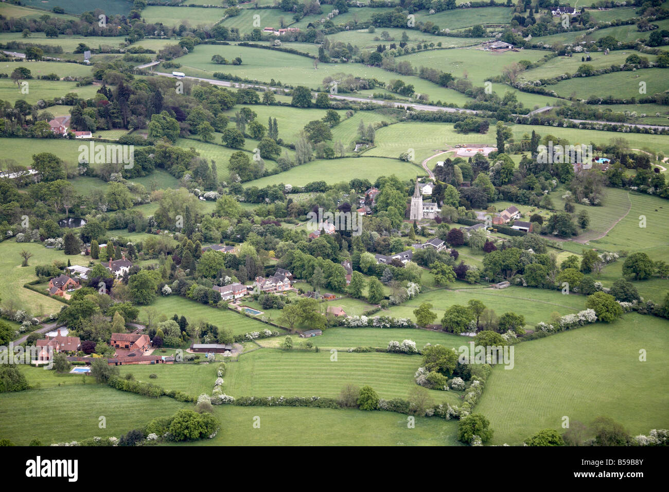 Aerial view south of Lapworth Village country houses gardens church fields trees Church Lane M40 Motorway Warwickshire - Stock Image