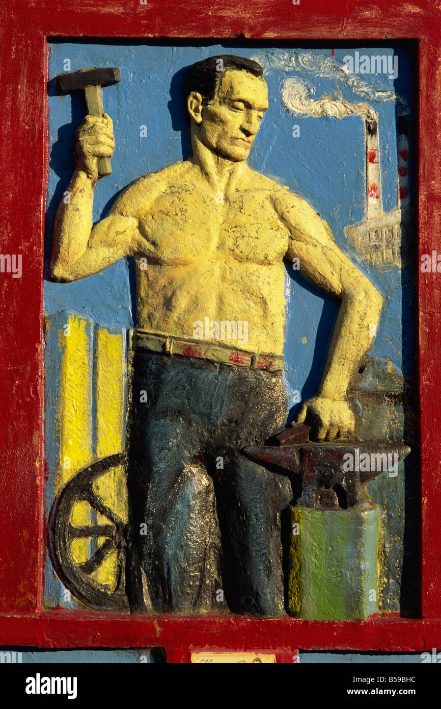 Murals adorn the walls of buildings in La Boca district, home to artists, Buenos Aires, Argentina, South America - Stock Image