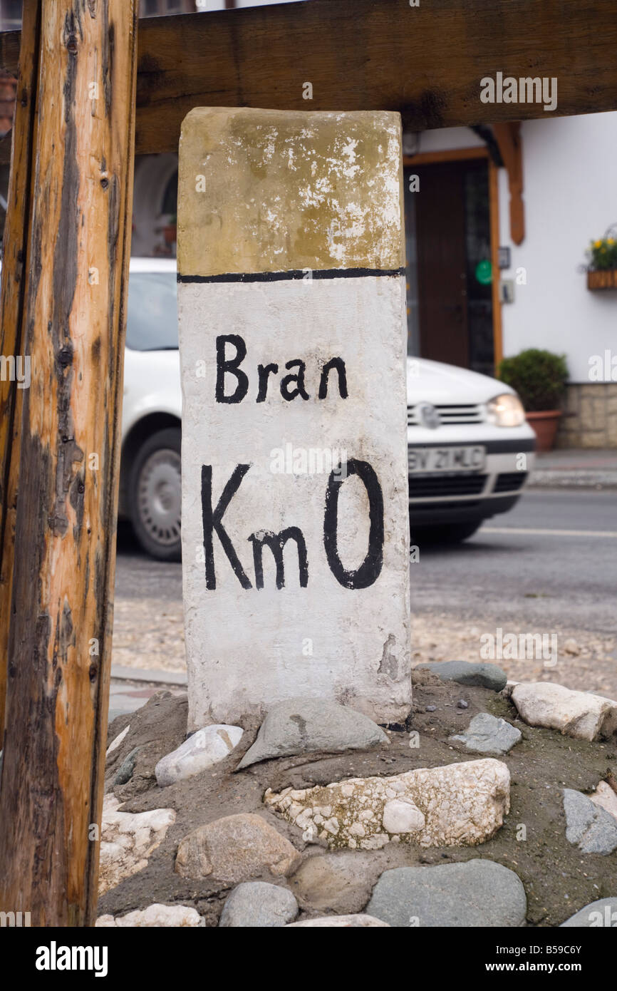 Bran Transylvania Romania Europe. Old distance road sign with kilometers to village centre milestone km metric marker - Stock Image