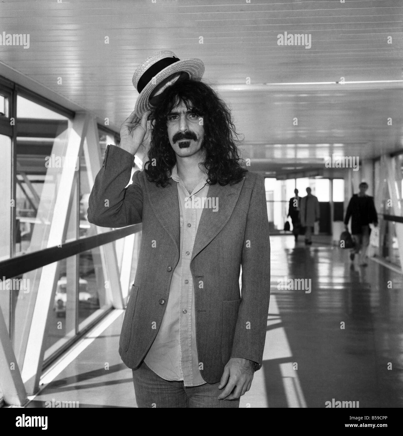 Rock Star Frank Zappa complete with straw boater hat at London's Heathrow airport. April 1975 75-1925 - Stock Image