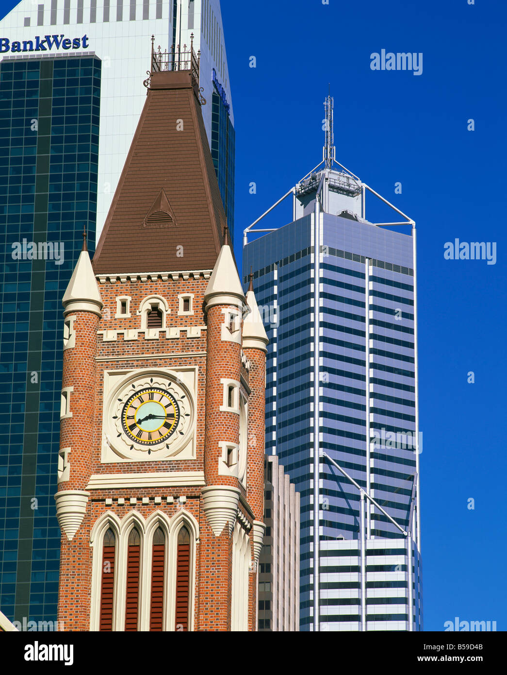 Old clock tower contrasts with new modern office blocks in the city of Perth Western Australia Australia Pacific - Stock Image