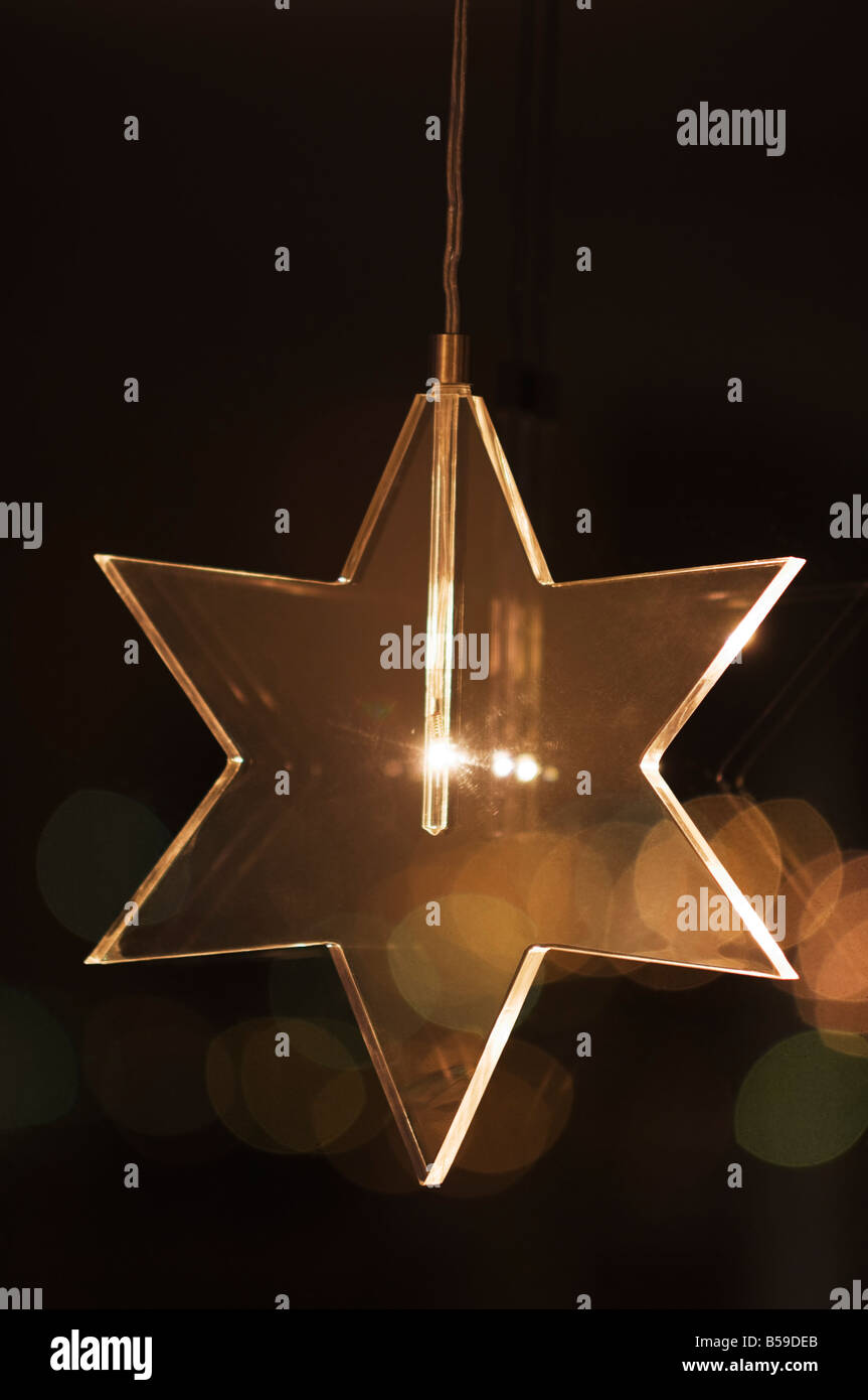Christmas star in window - Stock Image