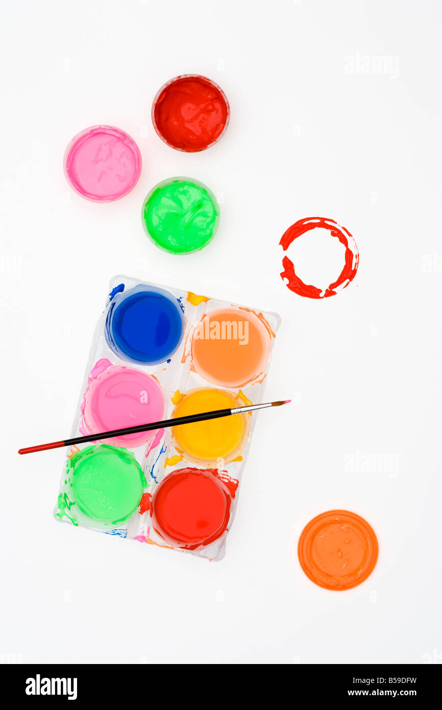 Poster paints and paint brush view from above - Stock Image