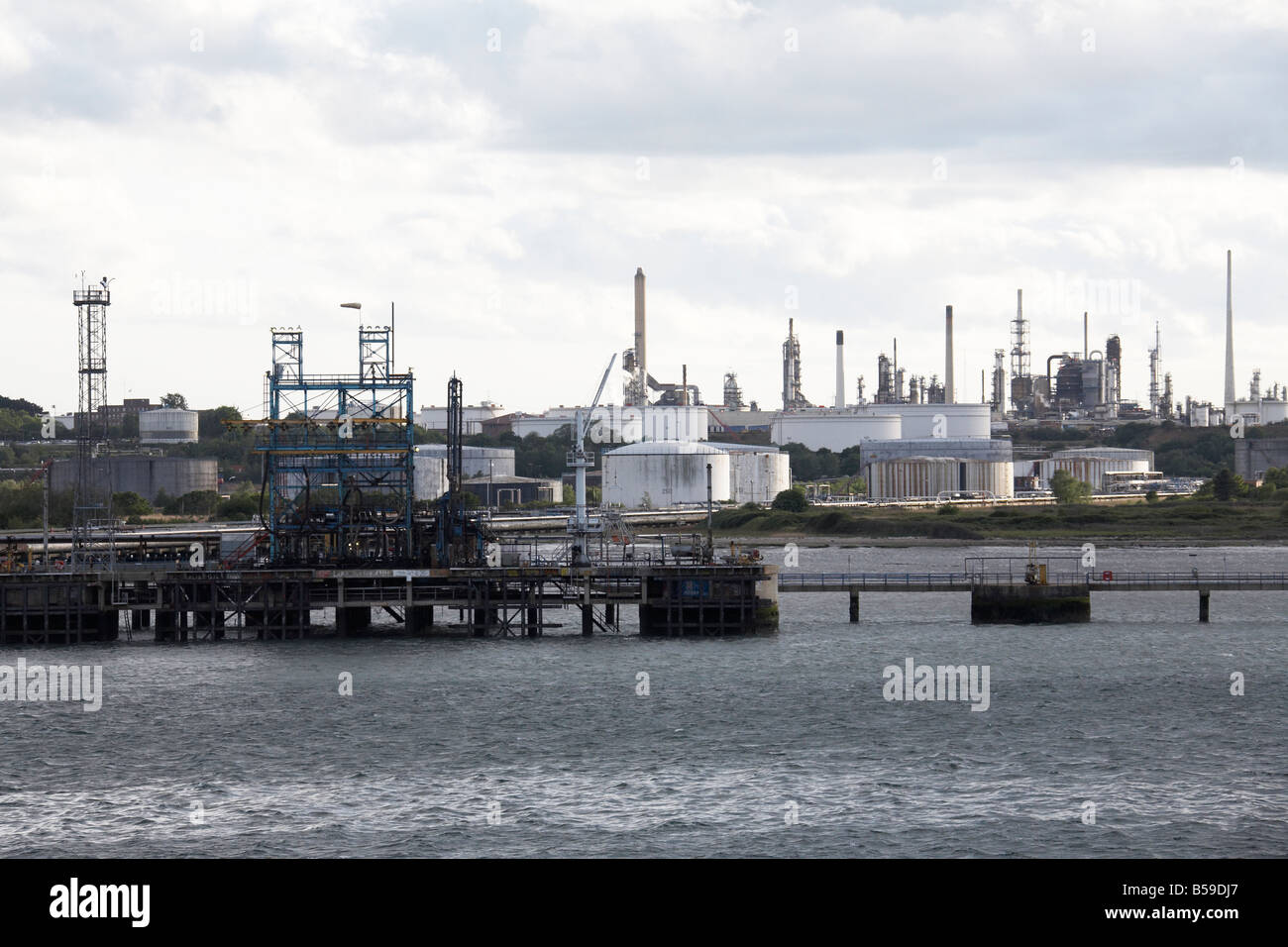 Fawley oil refinery port and natural gas terminal and storage depot tanks near Hythe Southampton Water England UK Stock Photo