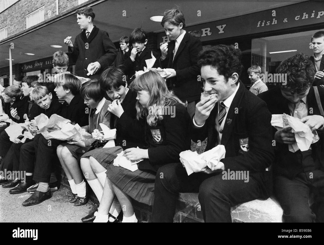 Childrens at St Augustine's secondary school in Hugton, eat sandwiches, fish and chips during school meals disputes - Stock Image