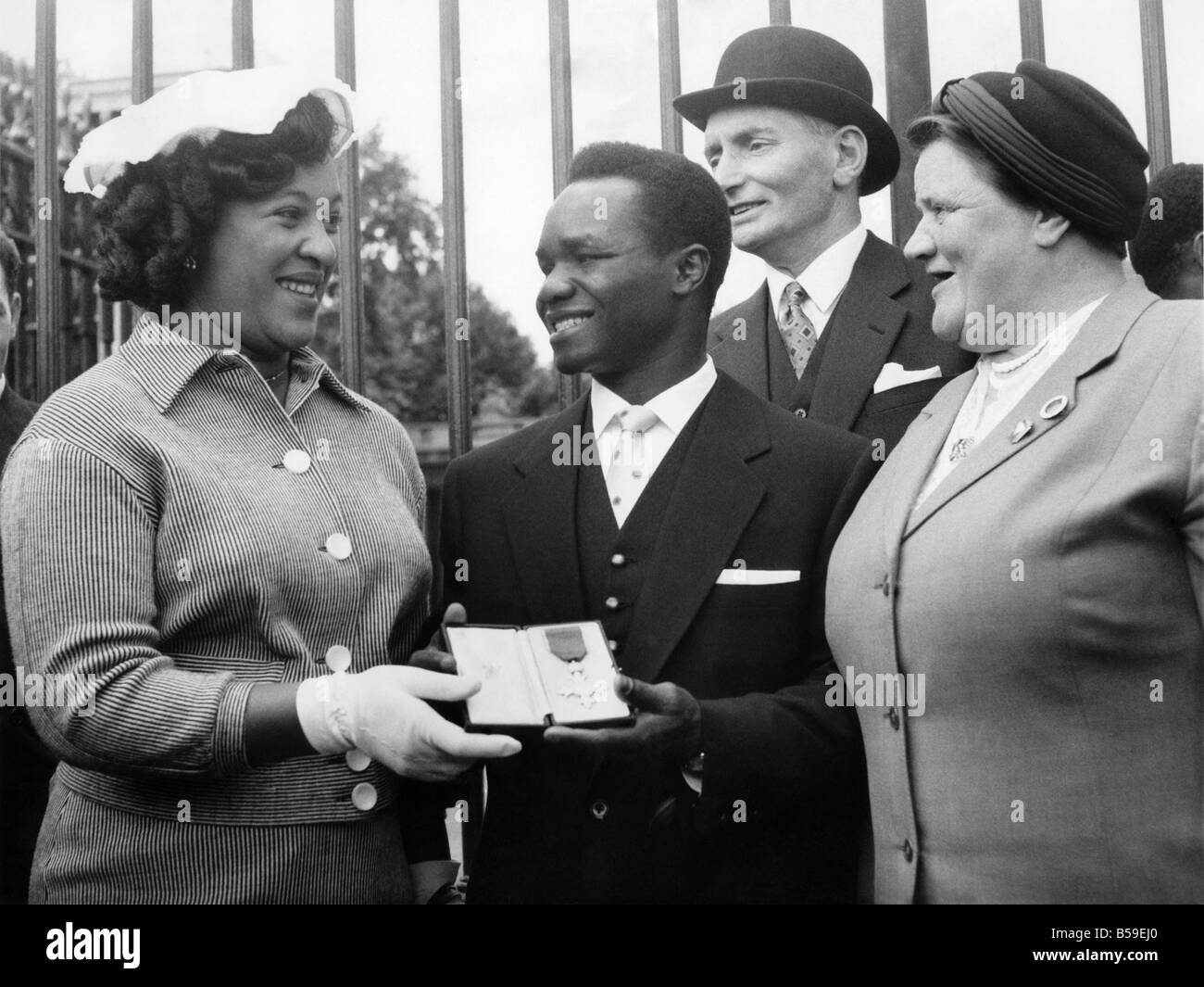 Nigerian boxer Hogan KId Bassey MBE outsise the Palace with wife and Bessie Braddock after being warded his medal - Stock Image