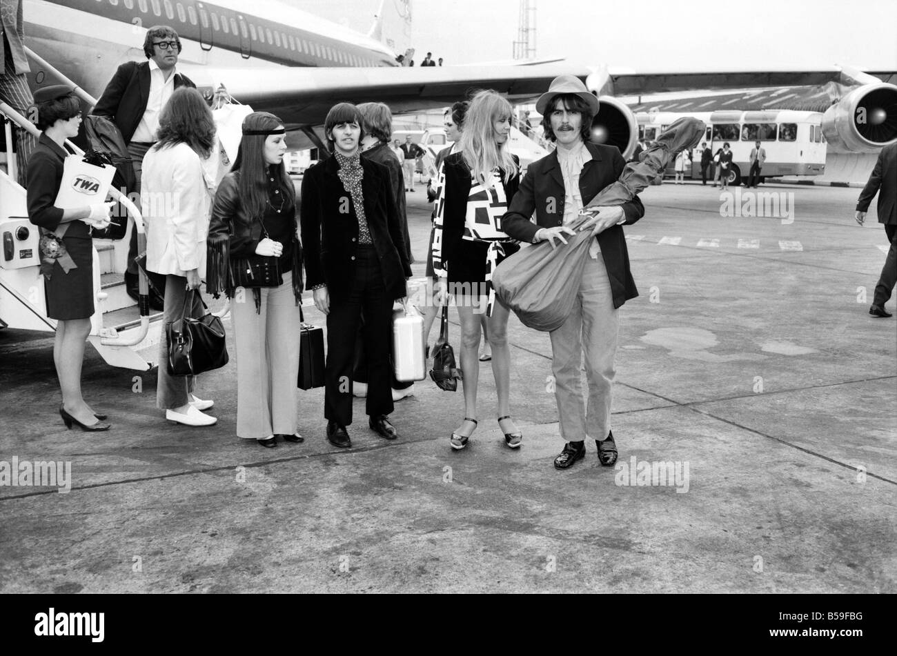 Beatles drummer Ringo Starr with wife Maureen and George Harrison with wife Pattie Boyd at Heathrow today. ;June - Stock Image