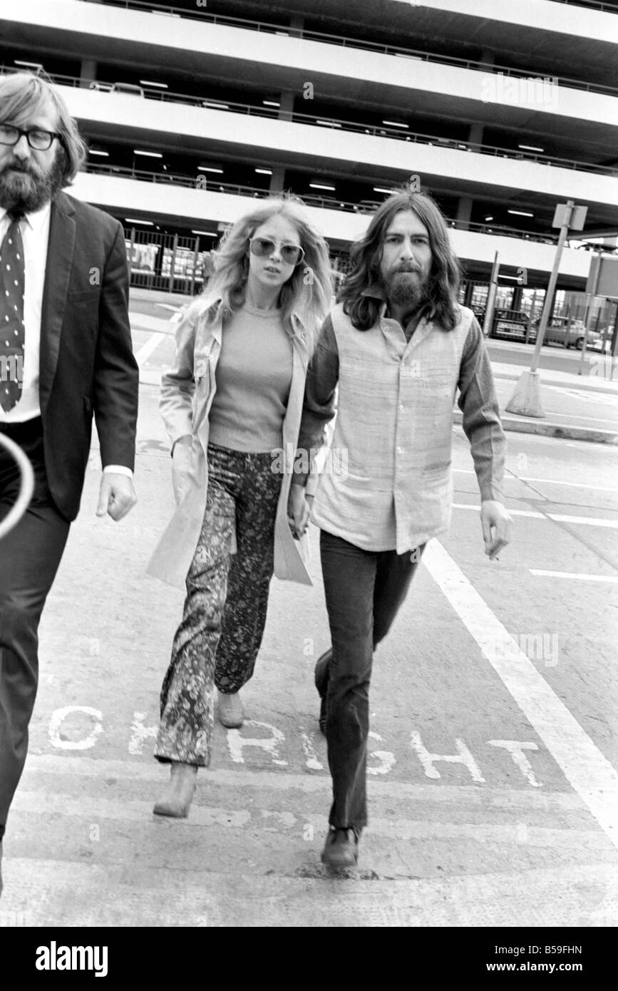George Harrison of the Beatles with his wife Pattie at Heathrow today after seeing offhis friend Bob Dylan. Sept. - Stock Image