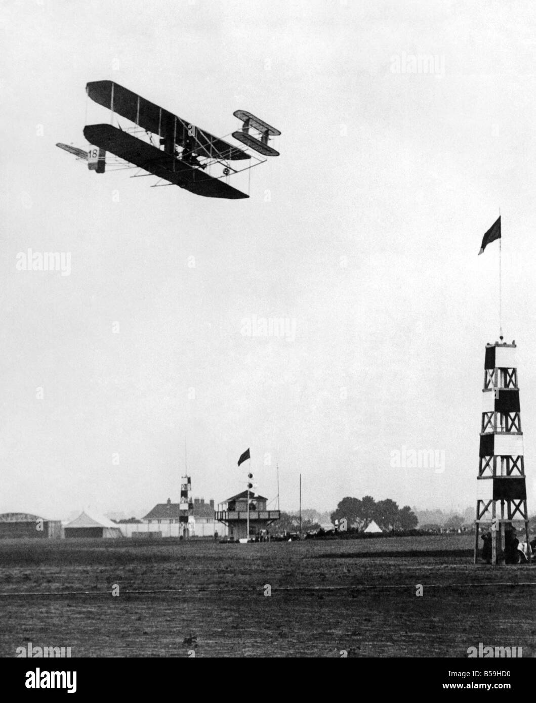 The Hon. Charles Rolls, holder of Royal Aero Club Certificate No.2, seen here flying his French built Wright bi - Stock Image