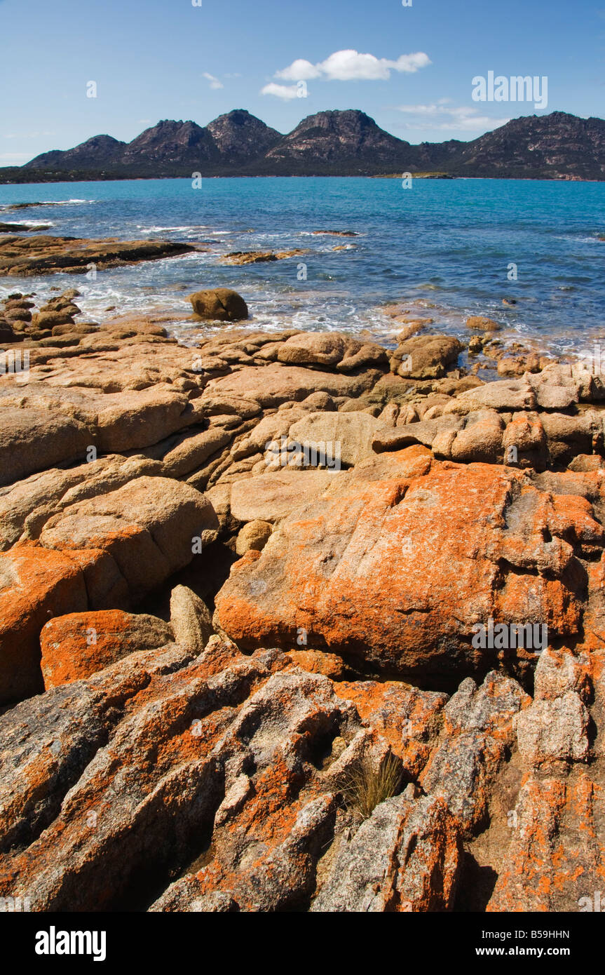 Lichen covered red granite rocks at the Hazards Mountain, Freycinet Peninsula, Freycinet National Park, Tasmania, - Stock Image
