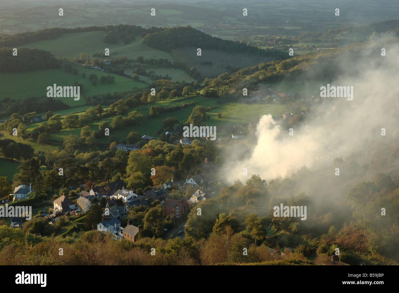 plume of smoke drifting across the Malvern Hills, Worcestershire, England, UK - Stock Image