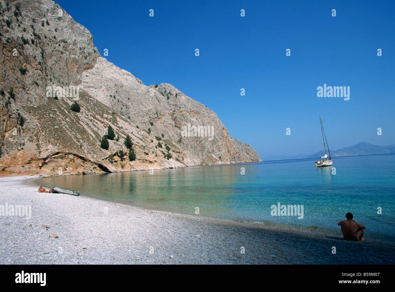 St George s Bay Symi Dodecanese Greek Islands Greece Europe - Stock Image