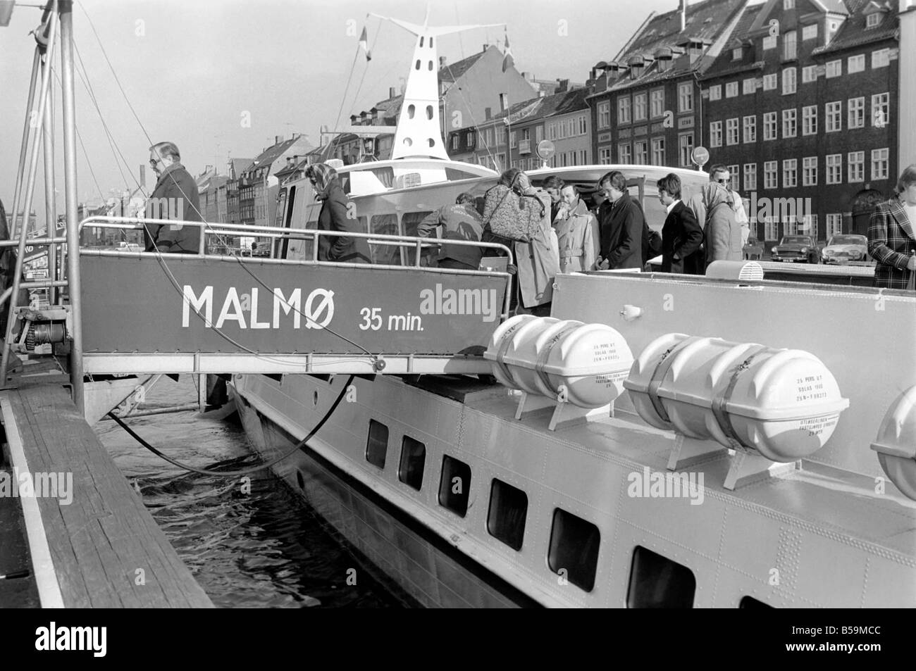 Passengers disembark from the Malmo (Sweden) hydrofoil at their final destination Copenhagen.May - Stock Image