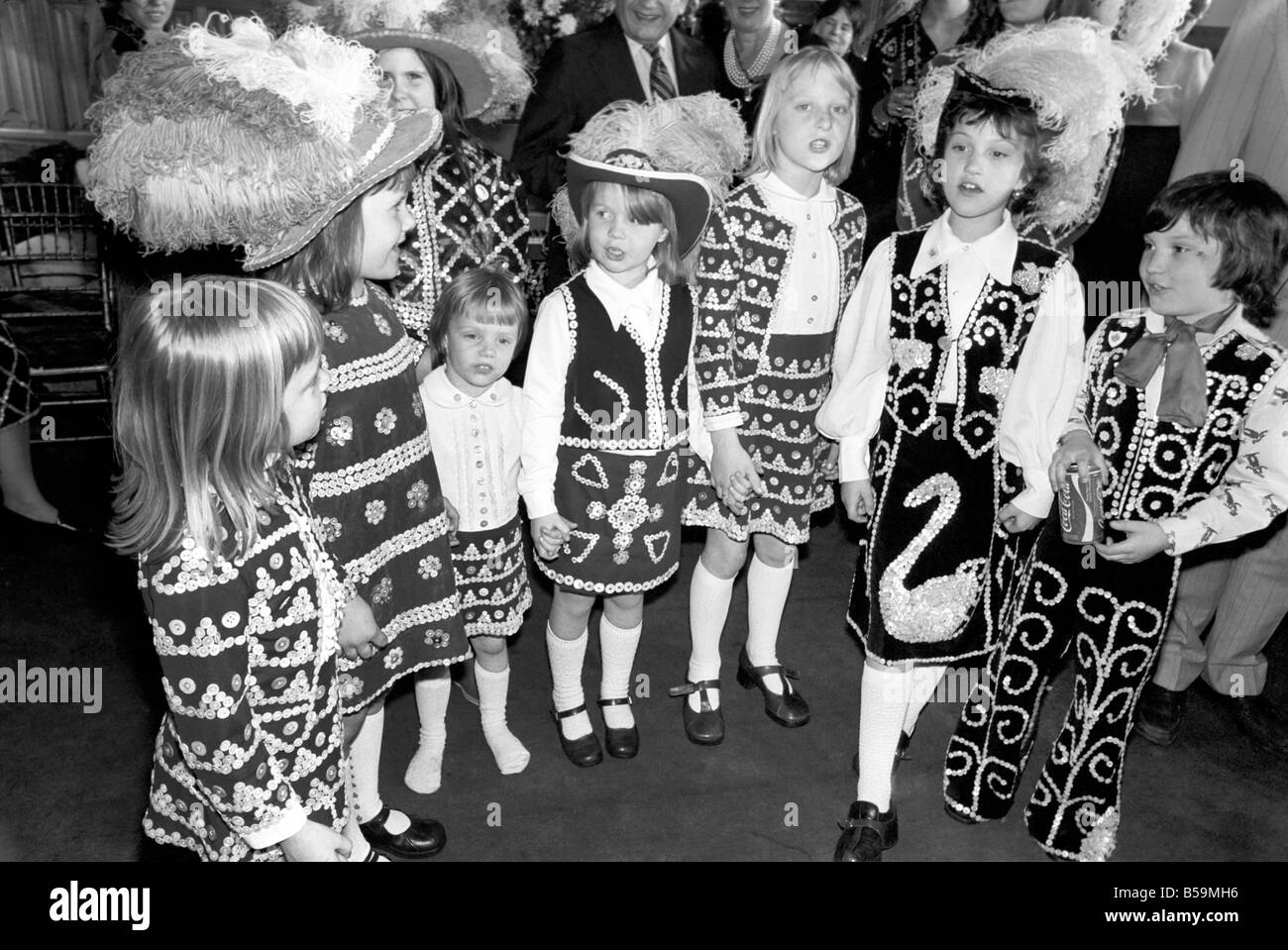 Younger members of the Pearly Kings and Queens seen here at a gathering of the families in the East End of London. - Stock Image