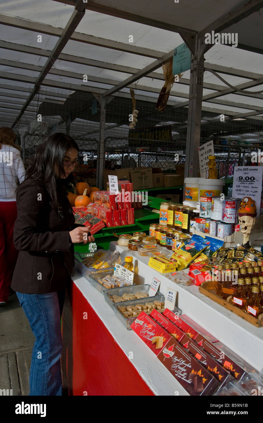 Tourist buying maple syrup products at a vendor stand in Byward Market area Ottawa Canada - Stock Image