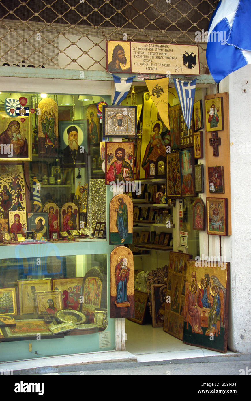 Icons paintings and religious artefacts for sale in a shop in the Plaka district of Athens Greece N Francis - Stock Image