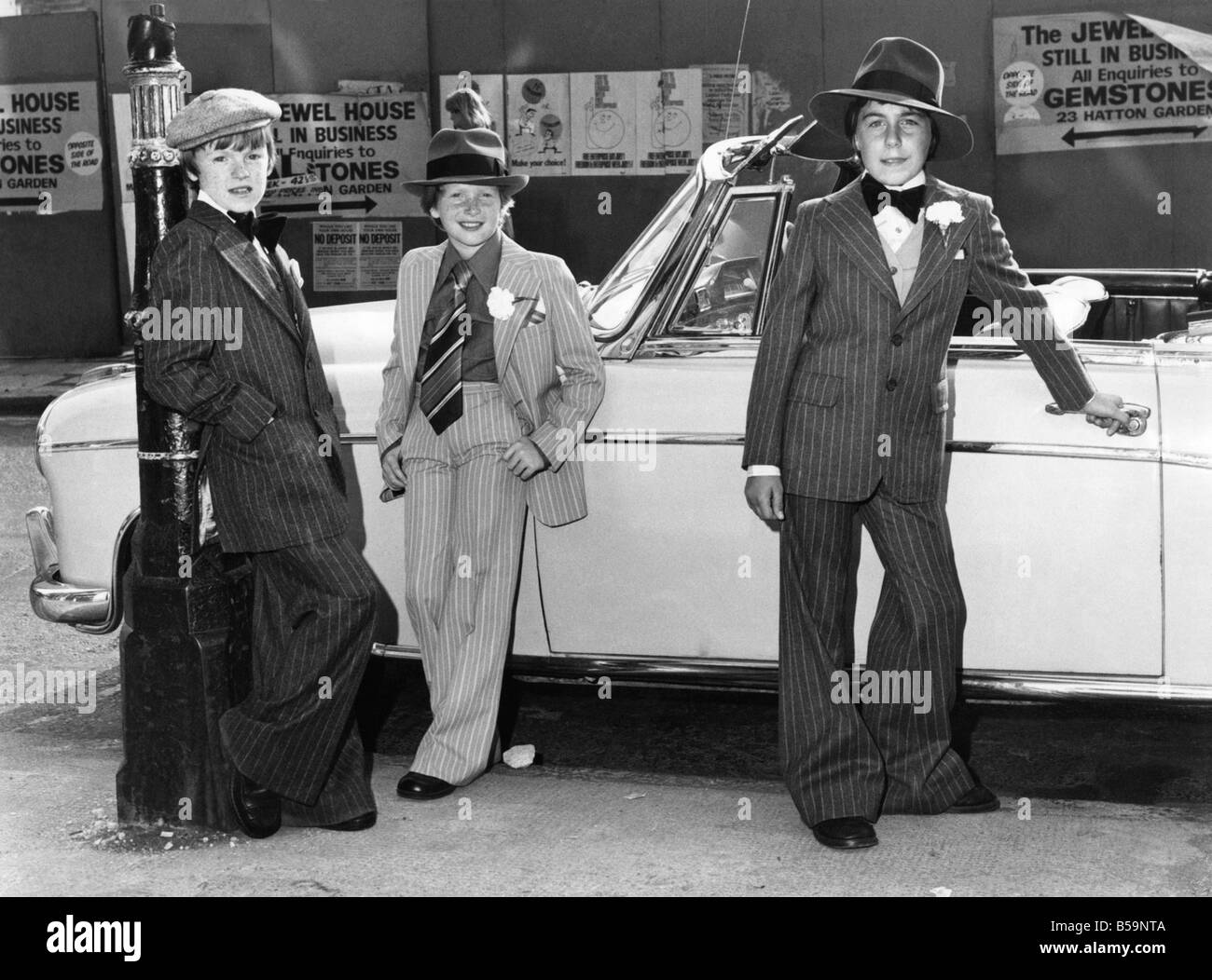 Modelling Bugsy Malone fashions, John Maunsell aged 12, (left) in a wool and nylon pinstripe suit, and cap. ;Simon - Stock Image