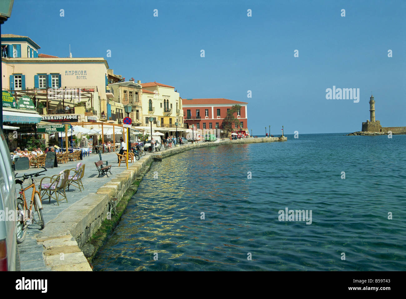 The harbour waterfront and the Venetian lighthouse Chania Crete Greece S Terry - Stock Image