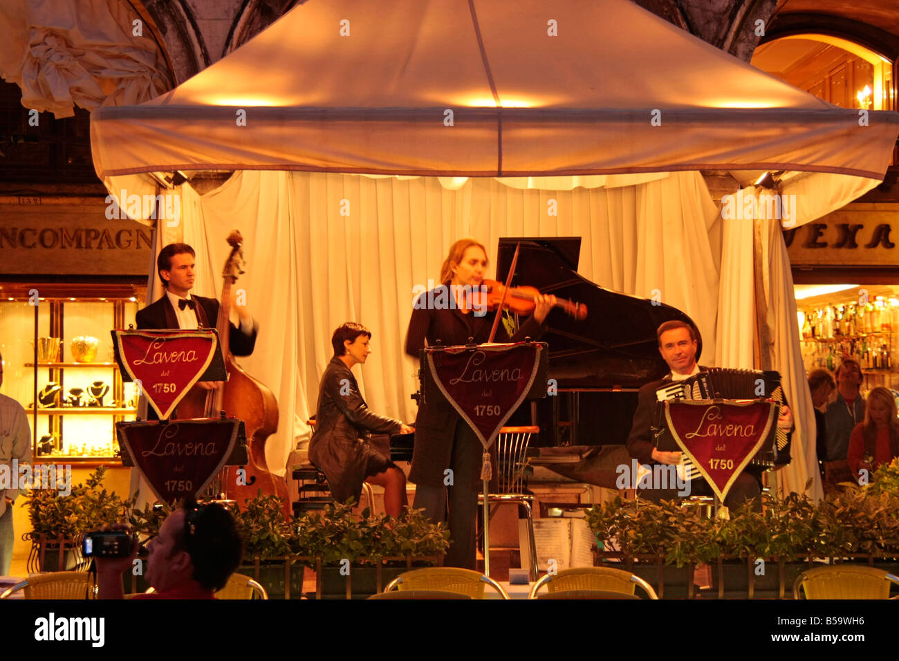 live band at the historic Caff Lavena on St Marks square in Venice Italy - Stock Image