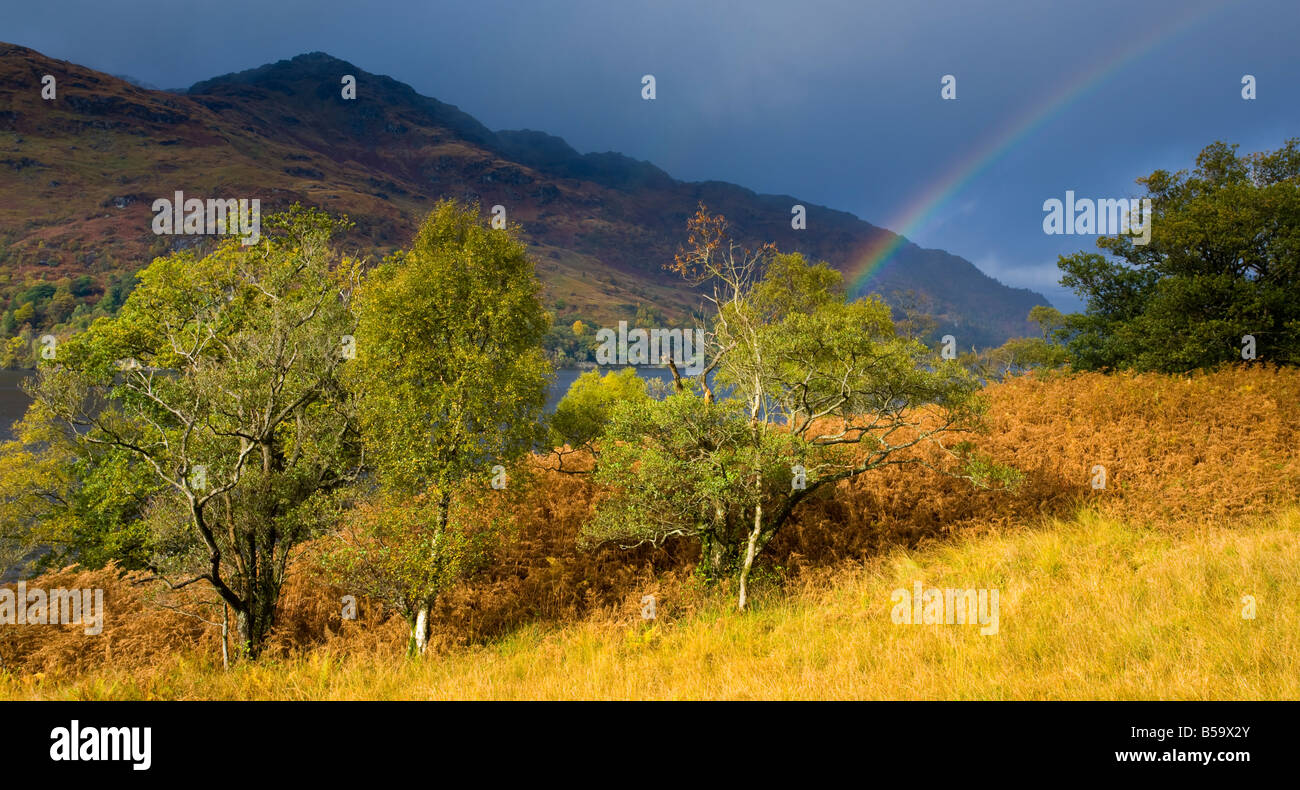 Scotland Stirling Loch Lomond and the Trossachs National Park Rainbow over the banks of Loch Lomond and nearby mountains Stock Photo