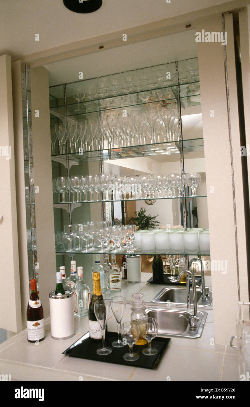 Close Up Of Wineglasses On Glass Shelves In Mirrored Alcove