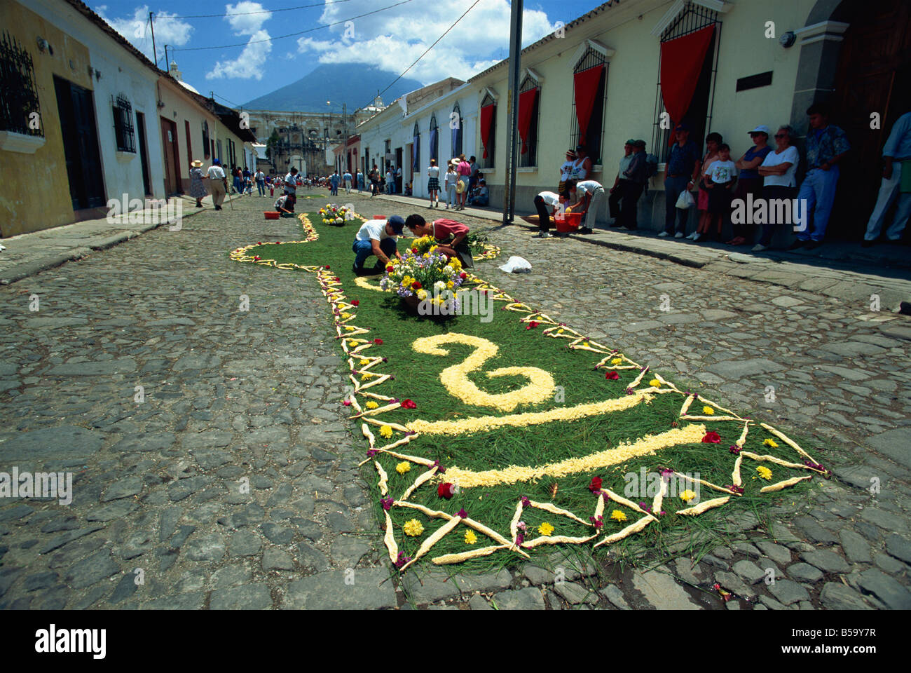 Carpet of plants and flowers being laid on a street for one of the Easter processions, Antigua, Guatemala, Central - Stock Image