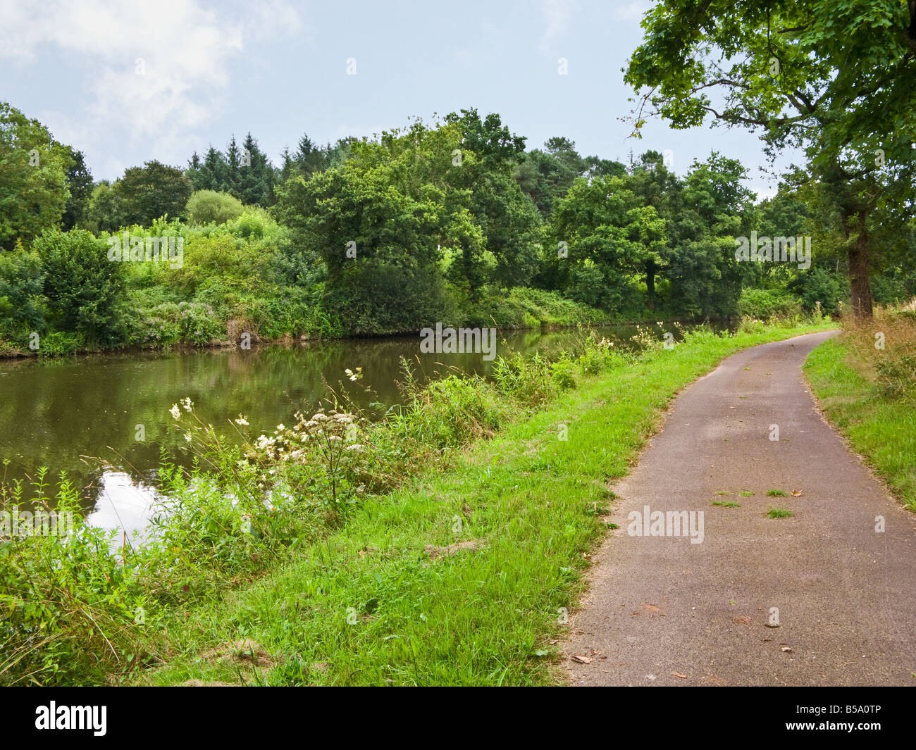 Towpath on the Nantes Brest Canal at Cadoret, Morbihan, Brittany, France, Europe - Stock Image