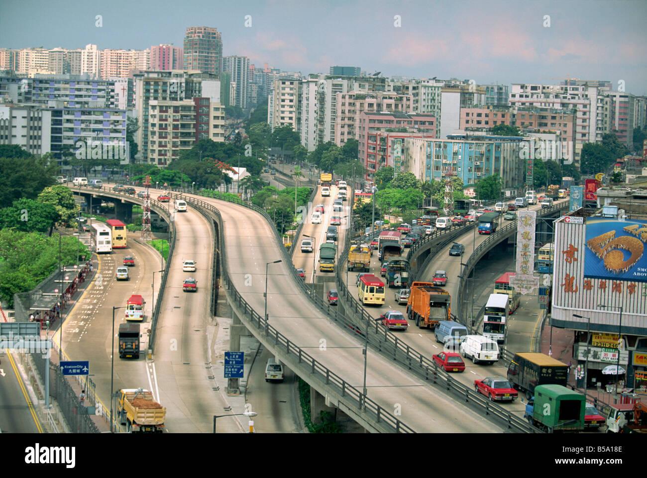 Traffic on flyovers near Kai Tak Airport, Kowloon, Hong Kong, China - Stock Image