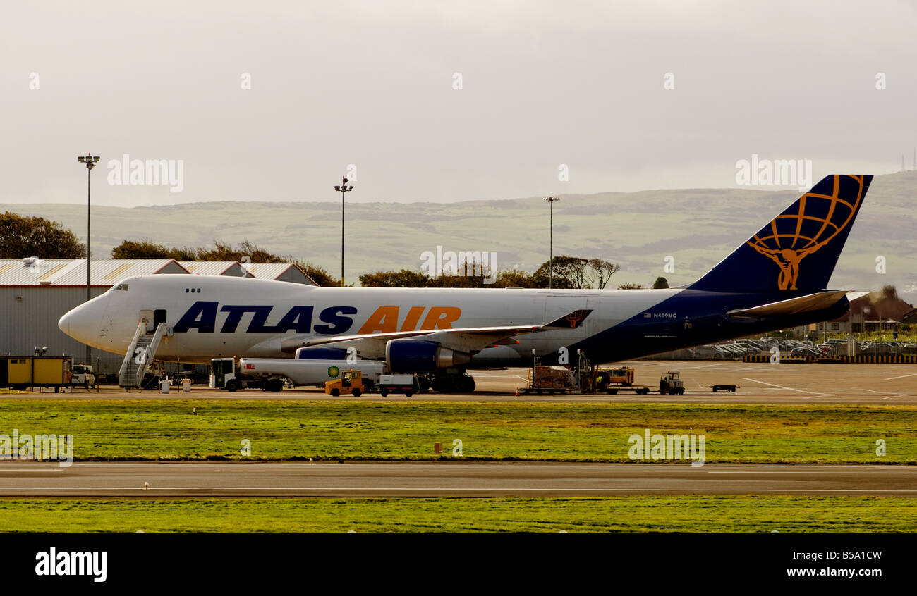 An Atlas Air Boeing 747 cargo airplane refueling on the tarmac at Glasgow Prestwick International Airport, Ayrshire, Stock Photo