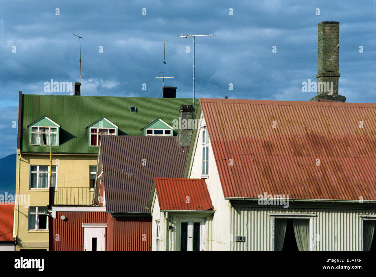 Typical colourful corrugated buildings which are a familiar sight in the city centre of Reykjavik, Iceland, Polar - Stock Image