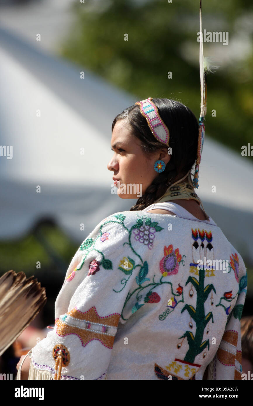 A female Native American Indian dancer at a Pow Wow at the Milwaukee Lakefront Indian Summer Festival Wisconsin - Stock Image