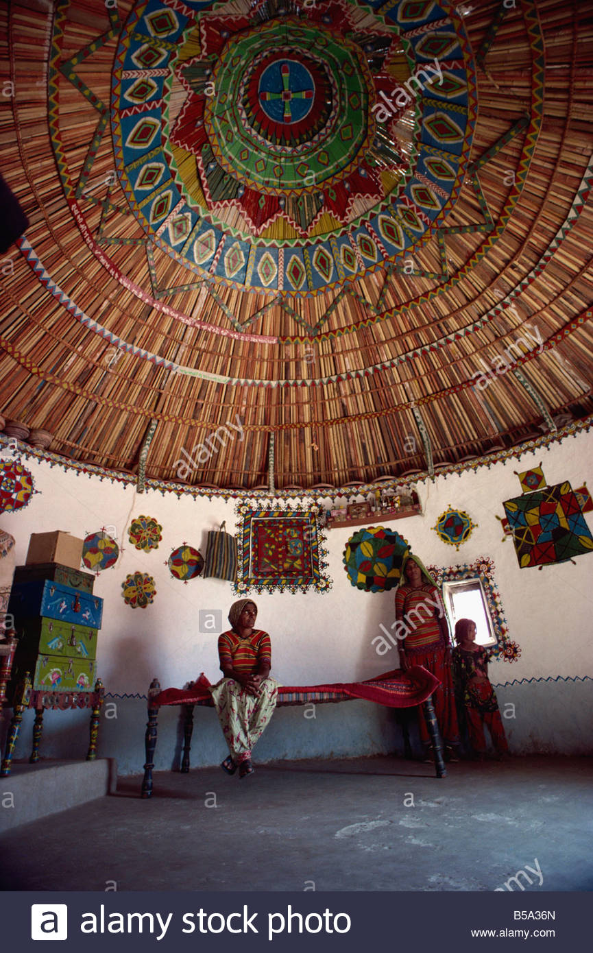 Hawabhai and painted ceiling in her house, Bherendiala, Kutch district, Gujarat state, India - Stock Image