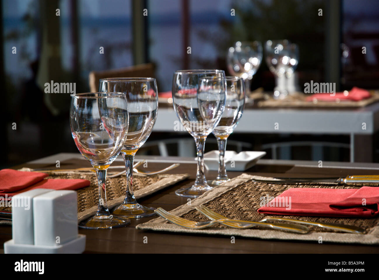 Table setting, wine glasses, water glasses on outdoor ...