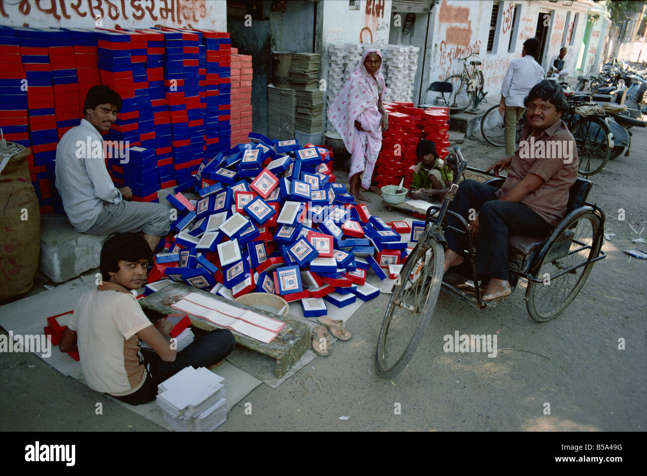Making sweet boxes and invalid s chair Ahmedabad Gujarat state India Asia - Stock Image