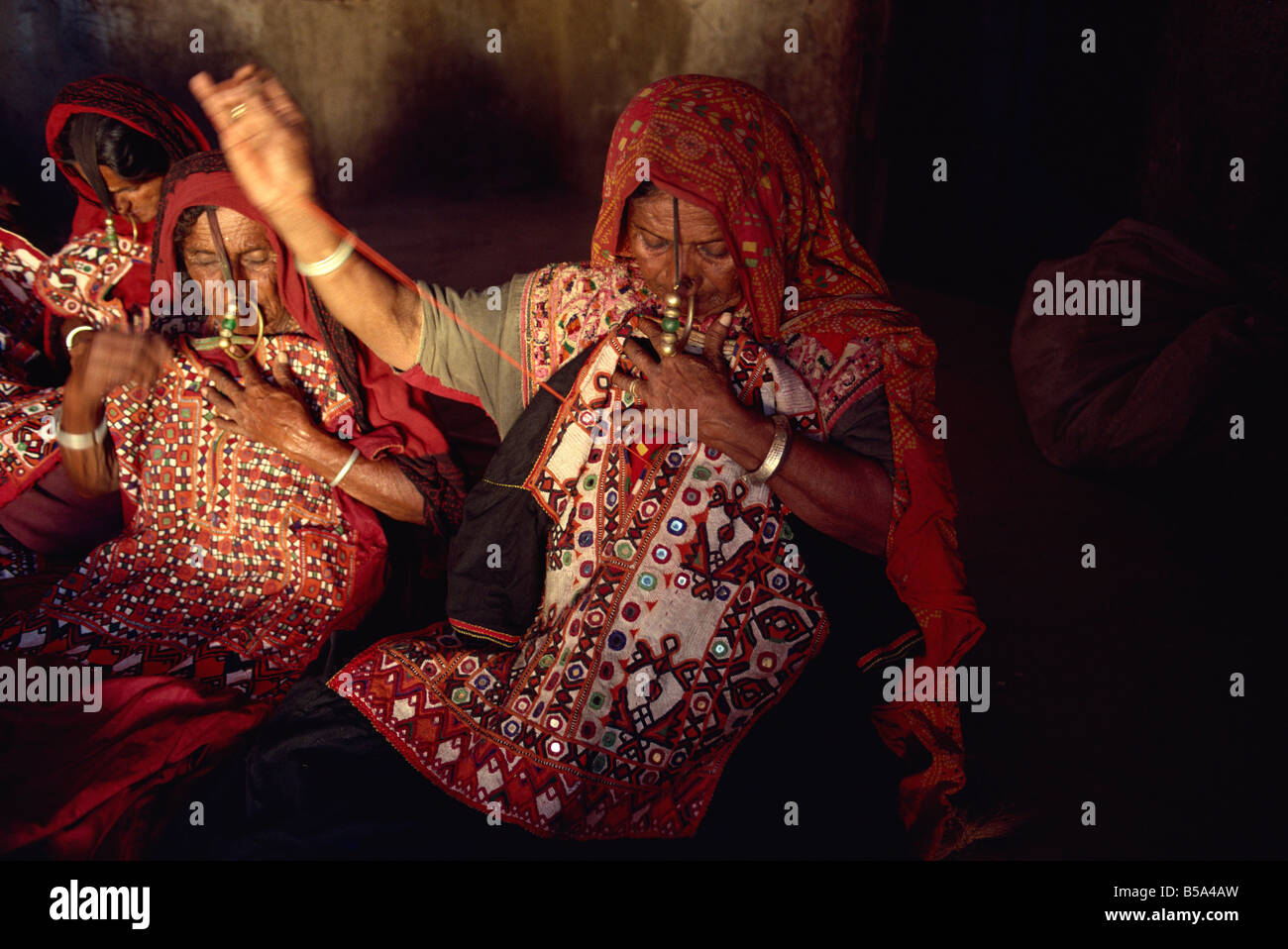 Muslim Jat tribes with gold nose rings famous for embroidery work Kutch district Gujarat state India Asia - Stock Image