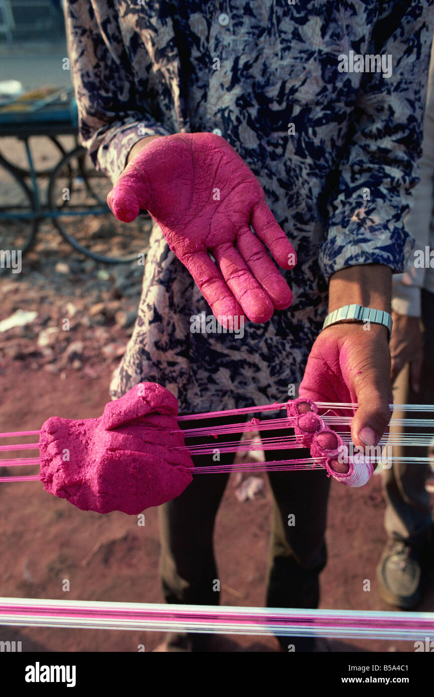Kite string production, string is coated in ground glass for fighting kite festival in January, Ahmedabad, Gujarat - Stock Image