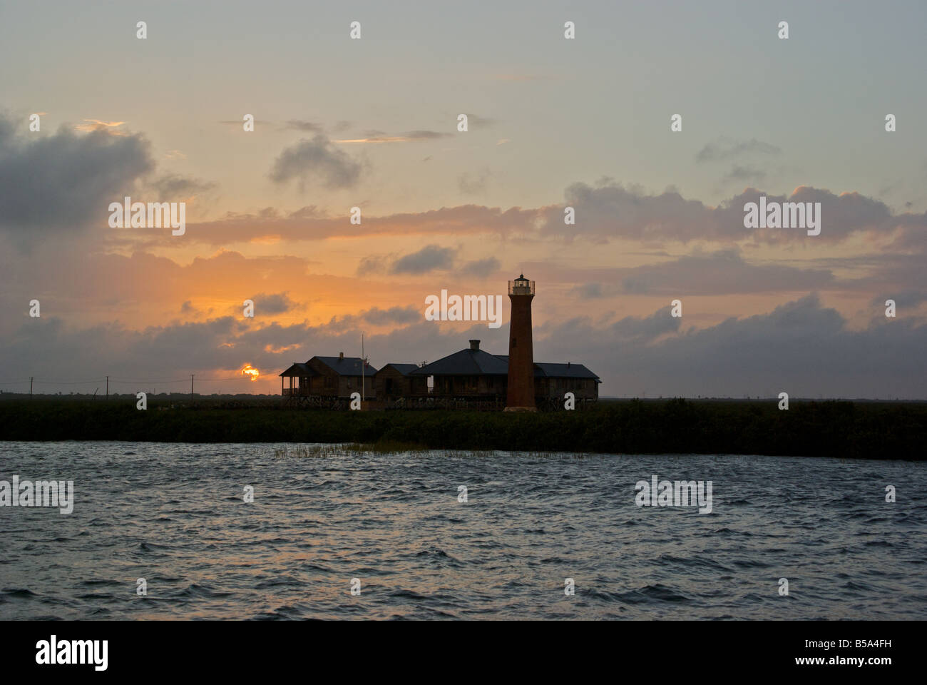 Dramatic sunset through clouds over Lydia Ann lighthouse at Aransas Pass - Stock Image