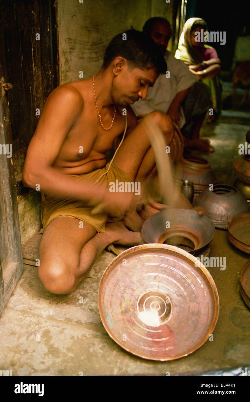 Brass beating India Asia - Stock Image