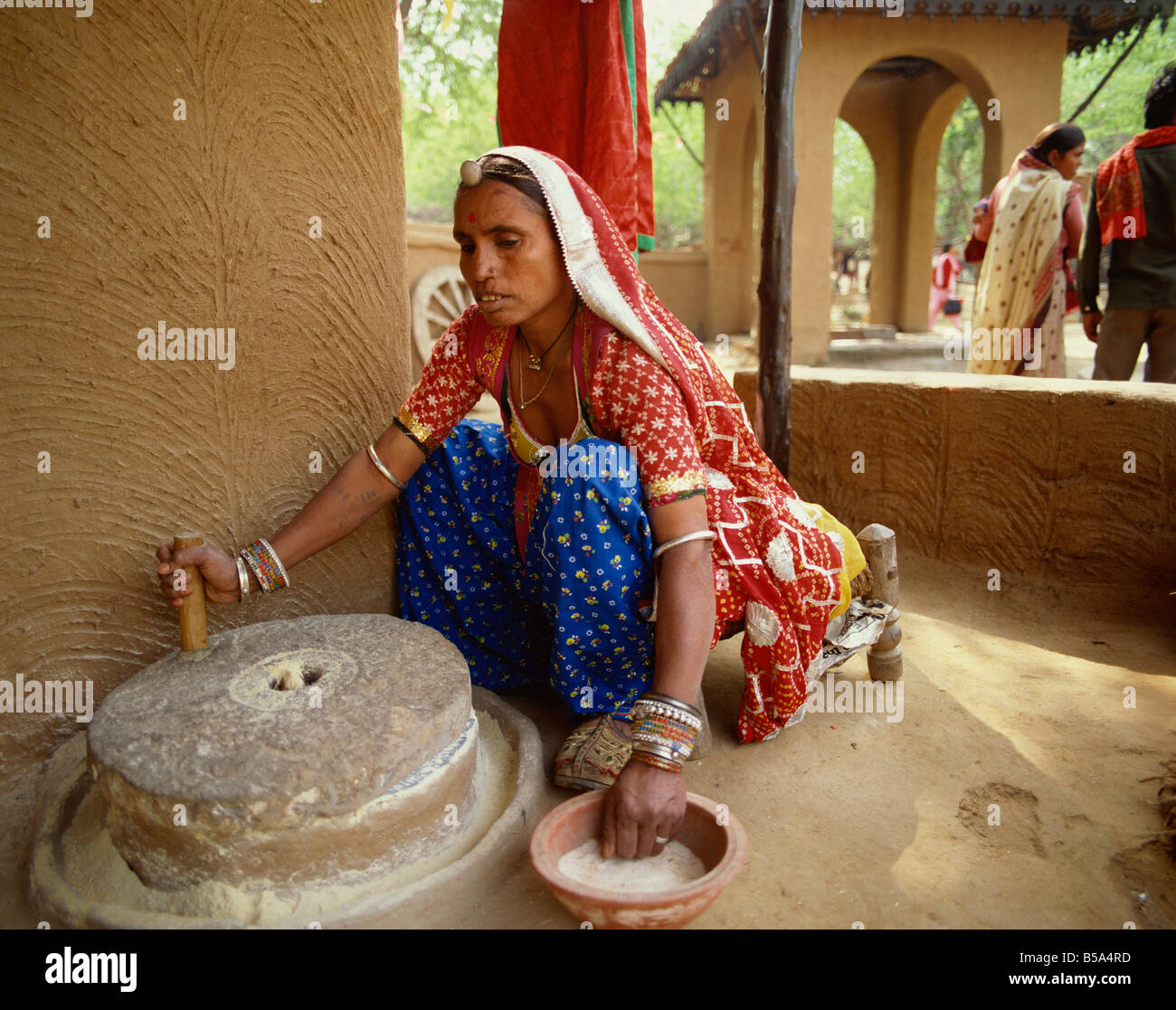 Woman Grinding Flour India