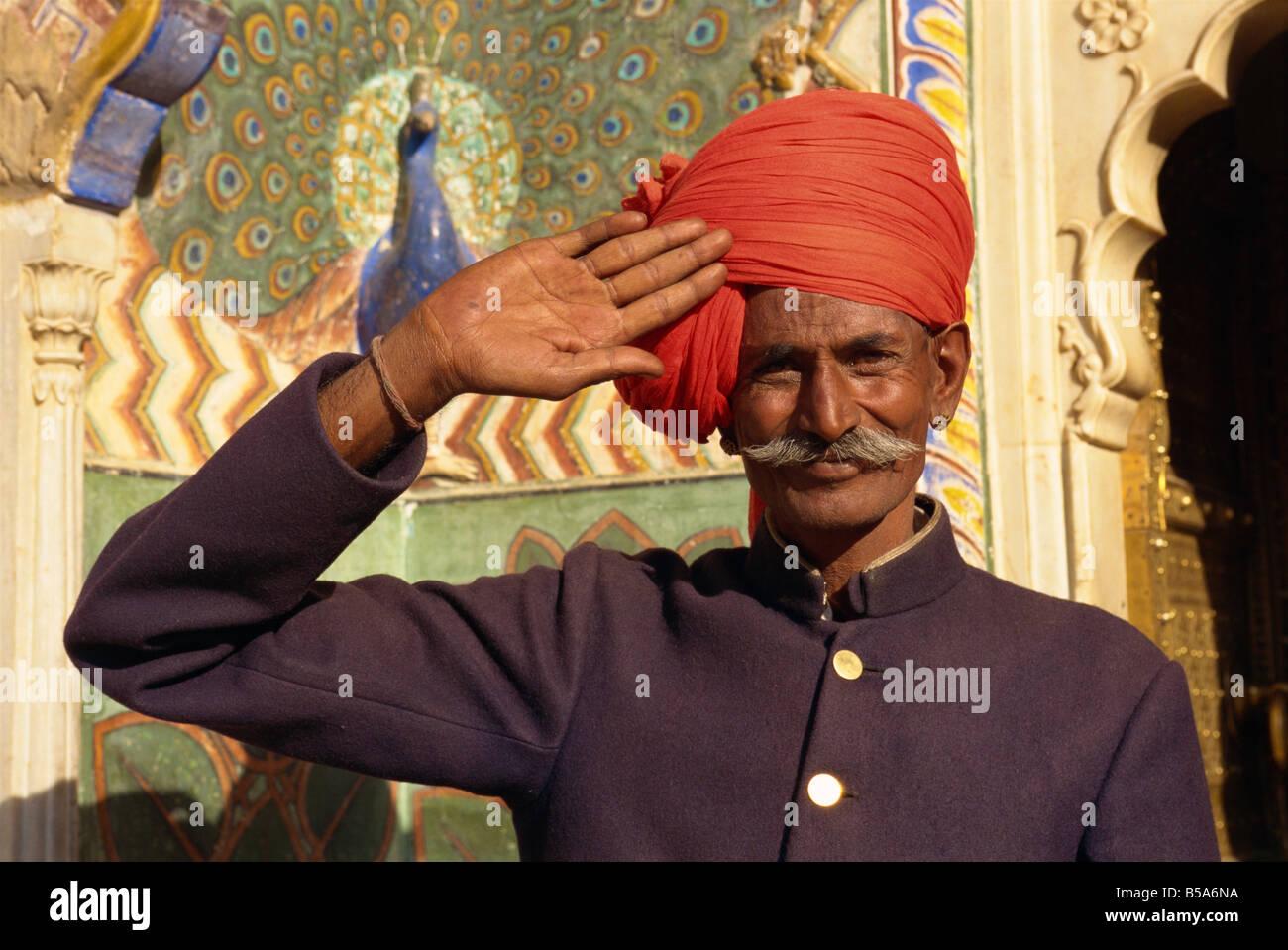 Guard in turban saluting at City Palace Jaipur Rajasthan state India Asia - Stock Image