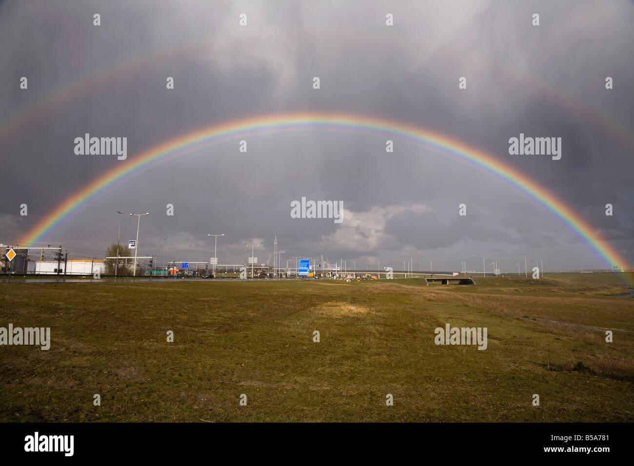 Rainbow and grassland near the Pernis cargo terminal near Rotterdam. Holland. The Netherlands (42) - Stock Image